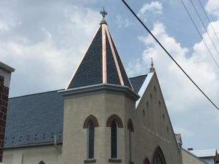 Copper flashing was installed to accent the steeple of the church.