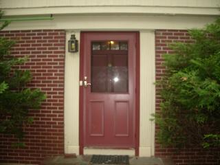Here's a before photo of the entry door to be replaced. There was some rot around it, impacting it's energy efficiency.