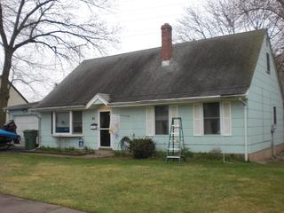 The first thing you might notice is the extreme wear of the 17-year-old roof or even the dated siding.
