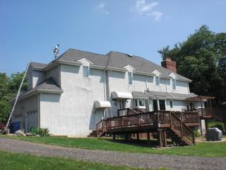 The original stucco on this home had trapped water, especially around the windows.