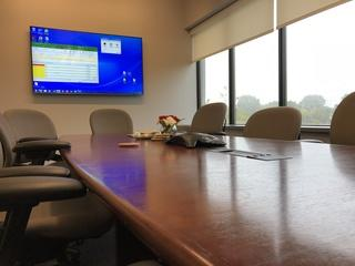 Conference room with Smart TV, networking and wifi is ready to go.