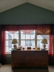 Here we can see the old worn out collection of three double hung windows.