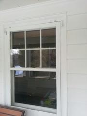 Here we can see the old windows looking worn and dated.
