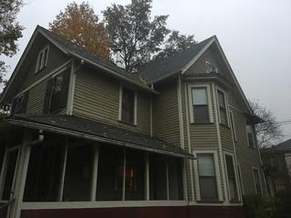 Here's a before photo of the existing asphalt roof.