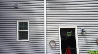 In order to center the awing over the door that leads to the patio, the crew had to remove the downspout and re-route the gutter system before installing the awning.