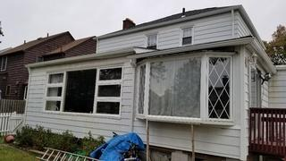 The exterior of these windows were well-worn with paint chipped away.