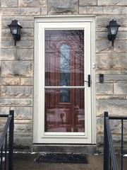 The new wooden ProVia entry door has beautiful glass in the center that adds an elegant touch to the front of this home.