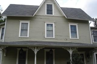 Here's a good before photo showing the two types of siding to be replaced.