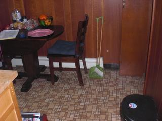 This photo shows the outdated flooring of this Philadelphia home.