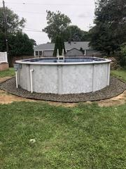 These homeowners in Jackson, NJ got a landscaping package to bring their pool installation to a close.