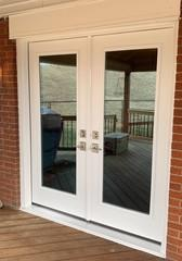 We love this upgrade - from an extremely dated sliding glass door to these beautiful double French doors!