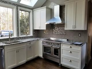 This customer chose to completely tile the kitchen walls, adding to the luxury feel of the space.  With brand new appliances and beautiful granite counter tops, this updated kitchen adds lots of value to the home.