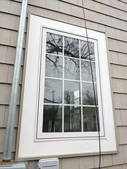 Overview photo of the window trim and siding repair.