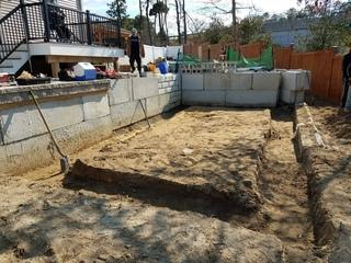 Our crew did a hand dig in this homeowner's backyard to prep the ground for a semi in-ground radiant pool installation