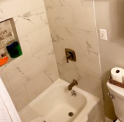 Photo of completed bathroom tub valve and tile installation.