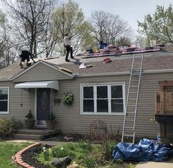 Our crew installing the Brownwood OC Duration Shingles.
