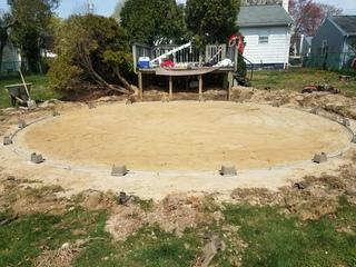 The old pool has been removed and the ground is re-leveled and prepped for installation