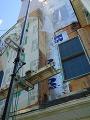 This photo shows some of the wood rot caused by the stucco siding.