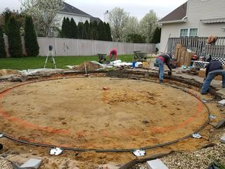 Once the existing pool was taken down and removed from the property the crew re-leveled the site by hand.