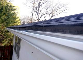 """New 5"""" gutters that were installed after tearing the old ones down."""