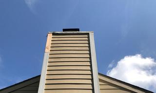 We removed and replaced the face of the chimney siding as well as the smooth cedar that was rotted.