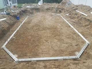 The ground is leveled and the pool walls are ready to be constructed