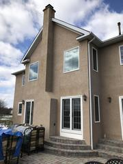 Here's the first glimpse of the stucco we replaced on this home.
