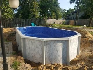 Once a base of sand is laid, it is smoothed and leveled to create a perfect pool floor!