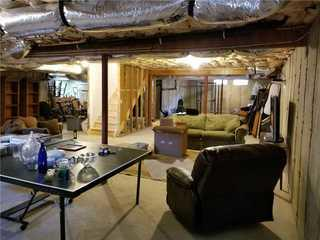 Unfinished walls and floors made the basement unappealing.