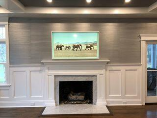 Gorgeous Frame TV installed over fireplace. This incredible Frame TV counteracts as a Framed piece of art on the wall when the TV is not being used.
