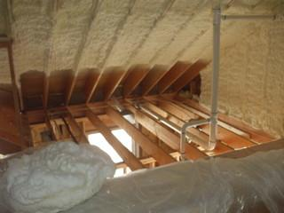 This photo depicts attic slopes that have been insulated with open cell foam.