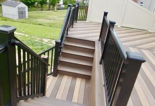 A mixture of Timbertech pecan, mocha and tigerwood legacy installed in Highland, IL.