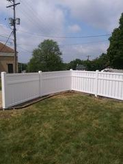 Our installers did a beautiful job on this 60' white vinly Glacier fence.