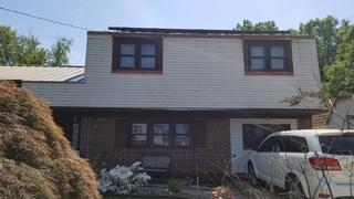 Here's an exterior shot of the brown vinyl windows to be replaced.