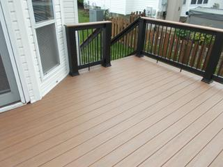 This Timbertech deck features Antique Palm decking.  The railing is black builder railing with Antigua Gold top caps.