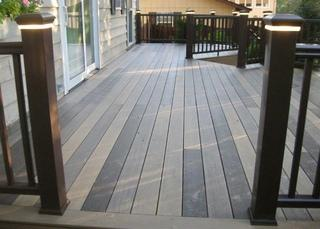 This is a Timbertech deck using Tiger, Mocha and Pecan.  The railing is Timbertech Express Kona rail.