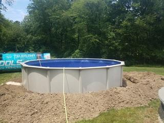 The ground was excavated, the pool walls were erected, the liner was installed and now is slowly filling with water