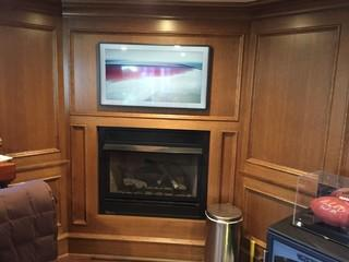 Frame TV installed in homeowners office over the fireplace.