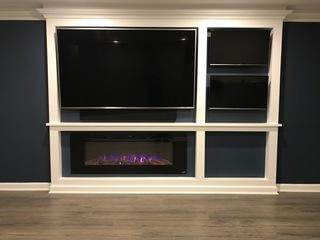 3 TV's installed and mounted on this custom built wall over fireplace.