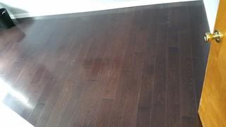 This photo shows the new darker wood flooring we installed in this home.