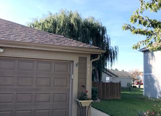 This photograph shows the new Owens Corning Duration Brownwood shingles.