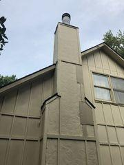 to damaged siding covering fireplace