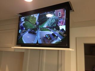 Motorized TV that hides away into the ceiling. View of security cameras.
