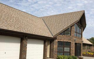 Photo of the New Roof over the garage and the center of the home.