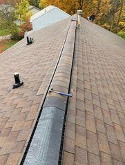 Here is a glance at our team finishing up the process of repairing this roof's ridge vent.