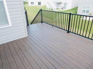 Saint Peters, Missouri home just upgraded their outdoor look with an Azek Brazilian Walnut deck.