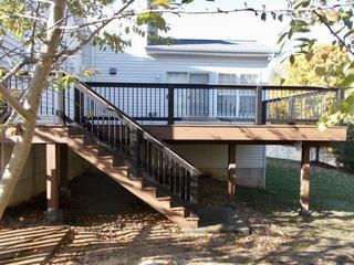 Timbertech Brown Oak deck with black builder rail in Shrewsbury, Missouri.