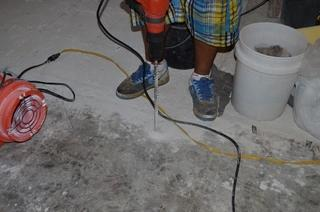 This is Ernest drilling the holes in order to pump the Poly in to raise the slab.