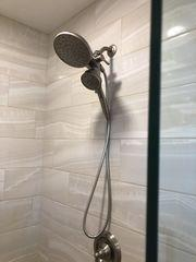 The new shower surround and shower head.