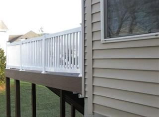 This is a Timbertech Dark Teak deck with white railing that was recently completed in Troy, Missouri.